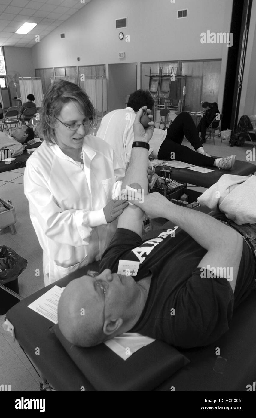 Man giving blood at a red cross blood drive Connecticut USA - Stock Image