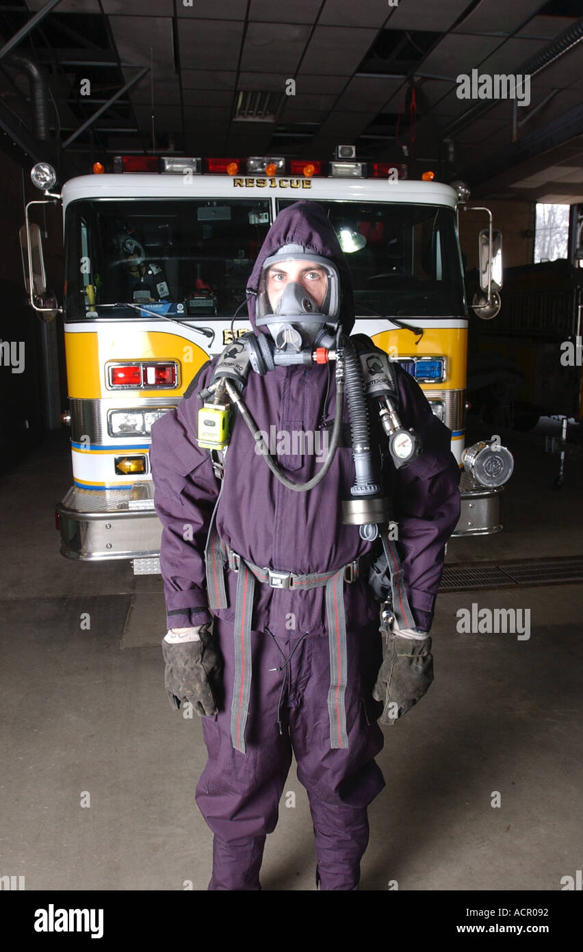 Firefighter with biohazard emergency gear mask and suit Stock Photo