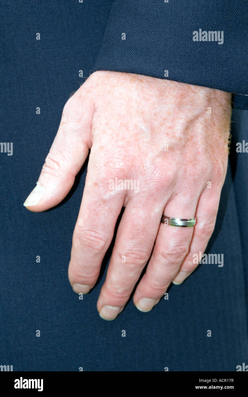 Wedding ring on a mans finger Stock Photo: 13212394 - Alamy