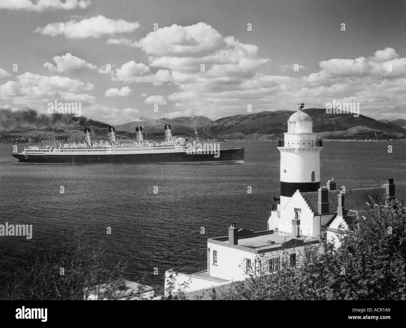 UK Scotland Firth of Clyde The Clock Lighthouse and SS  Aquitania in 1950 to be scrapped in the Gareloch Built in  1914 - Stock Image