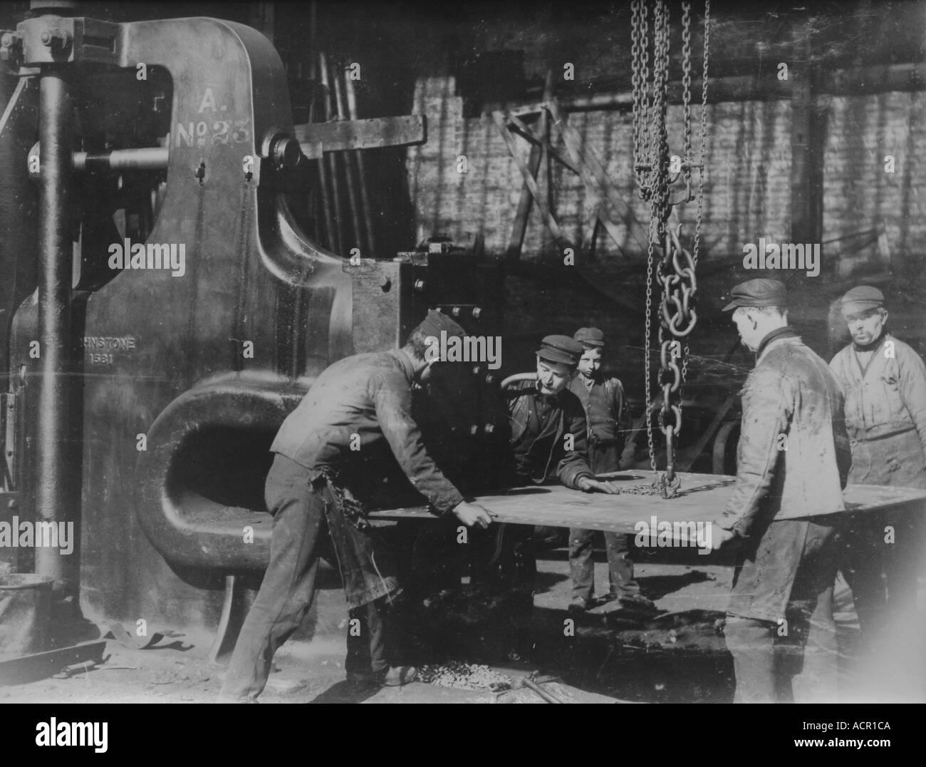 UK Scotland Greenock Shipyard Punching holes in sheet metal for rivits 1890 s - Stock Image