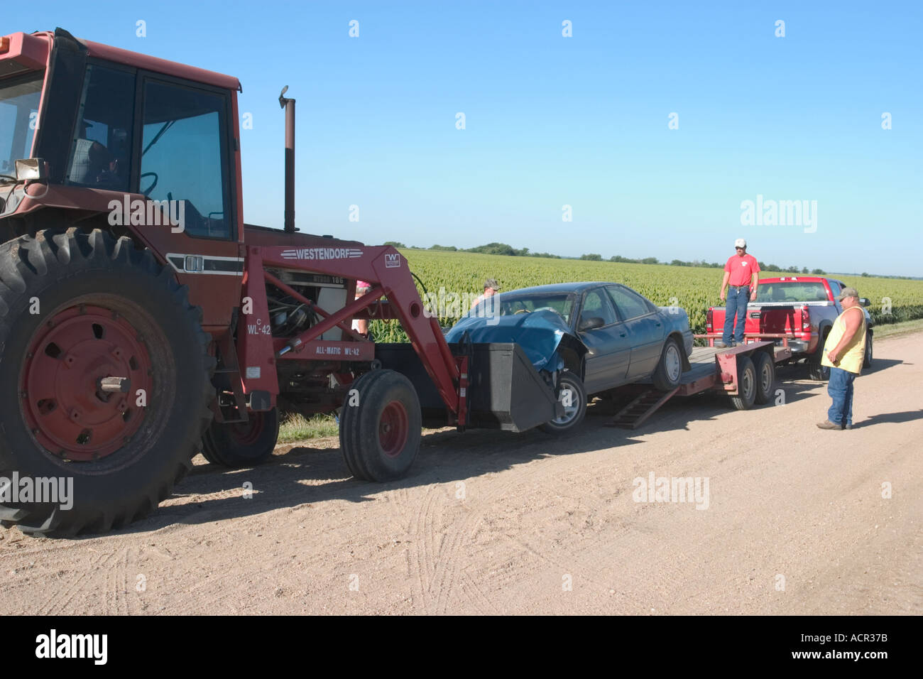 Traffic accident in rural Nebraska Farmer with a tractor helping out