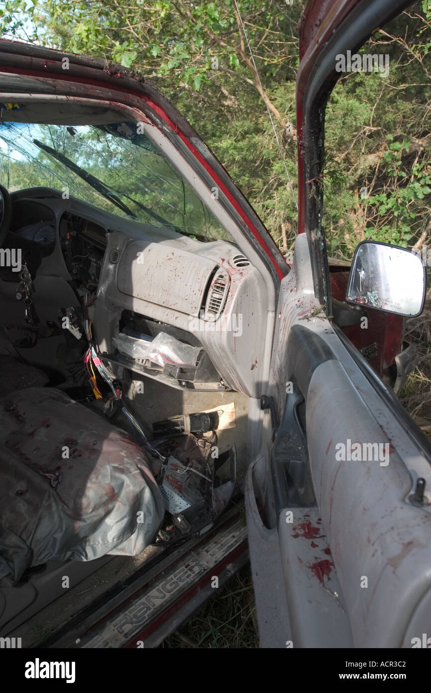Vehicle involved in fatality traffic accident Blood splatter and smears on vehicle ceiling dashboard door panels and airbag - Stock Image