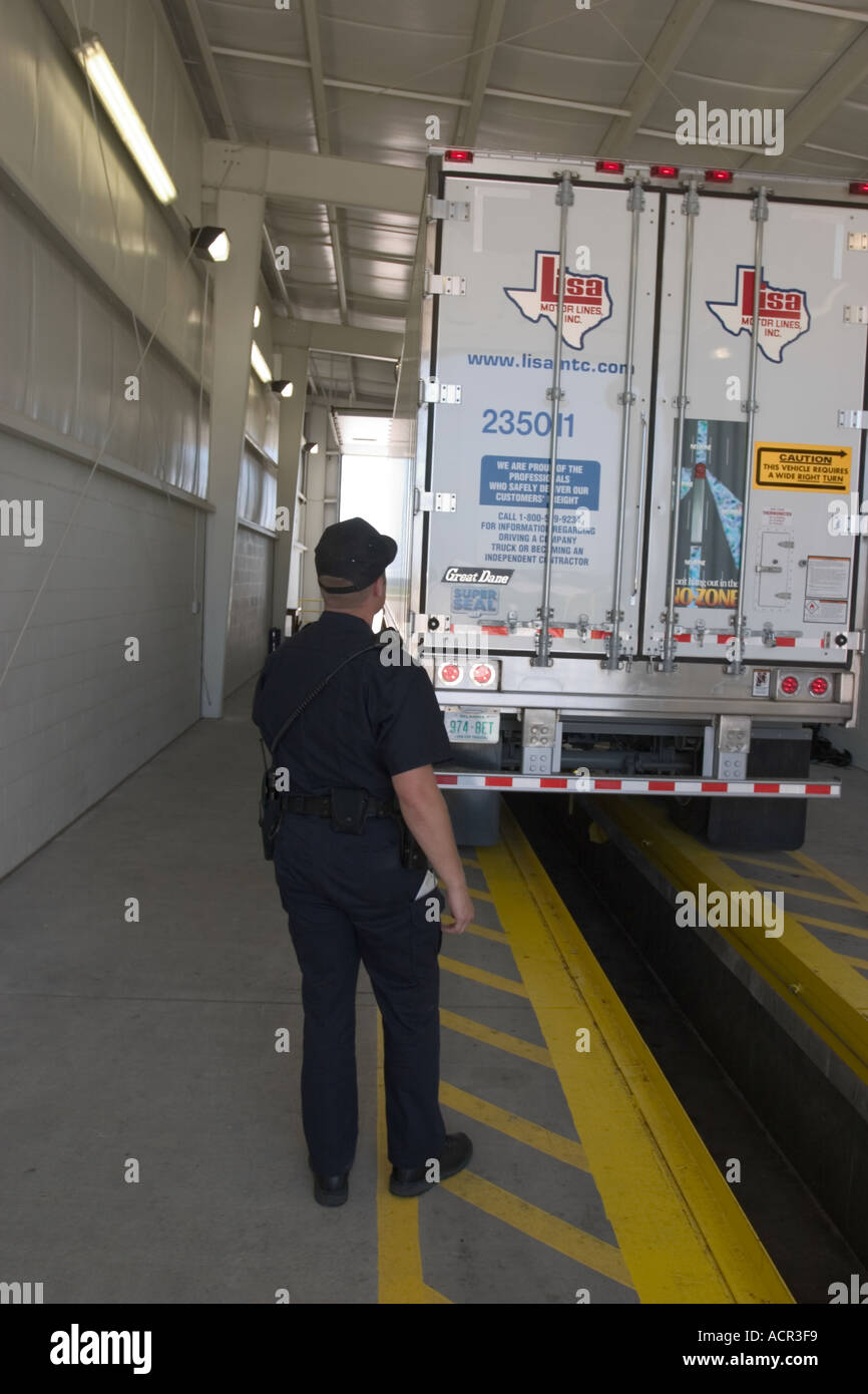 State Patrol Trooper inspects a commercial truck ( lorry