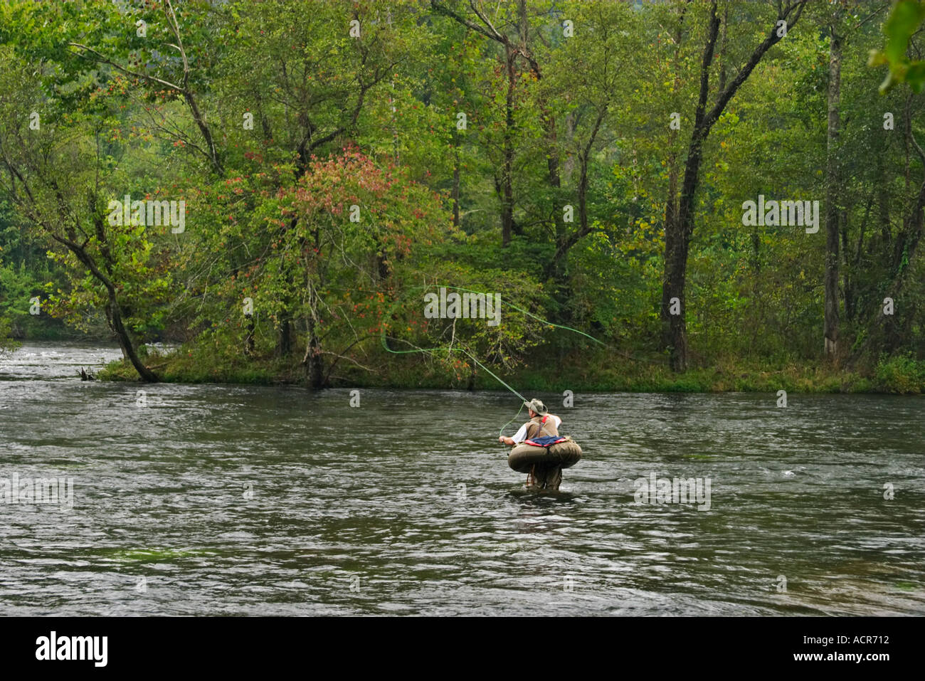 Fly Fisherman in float tube trout fishing the Hiwassee River