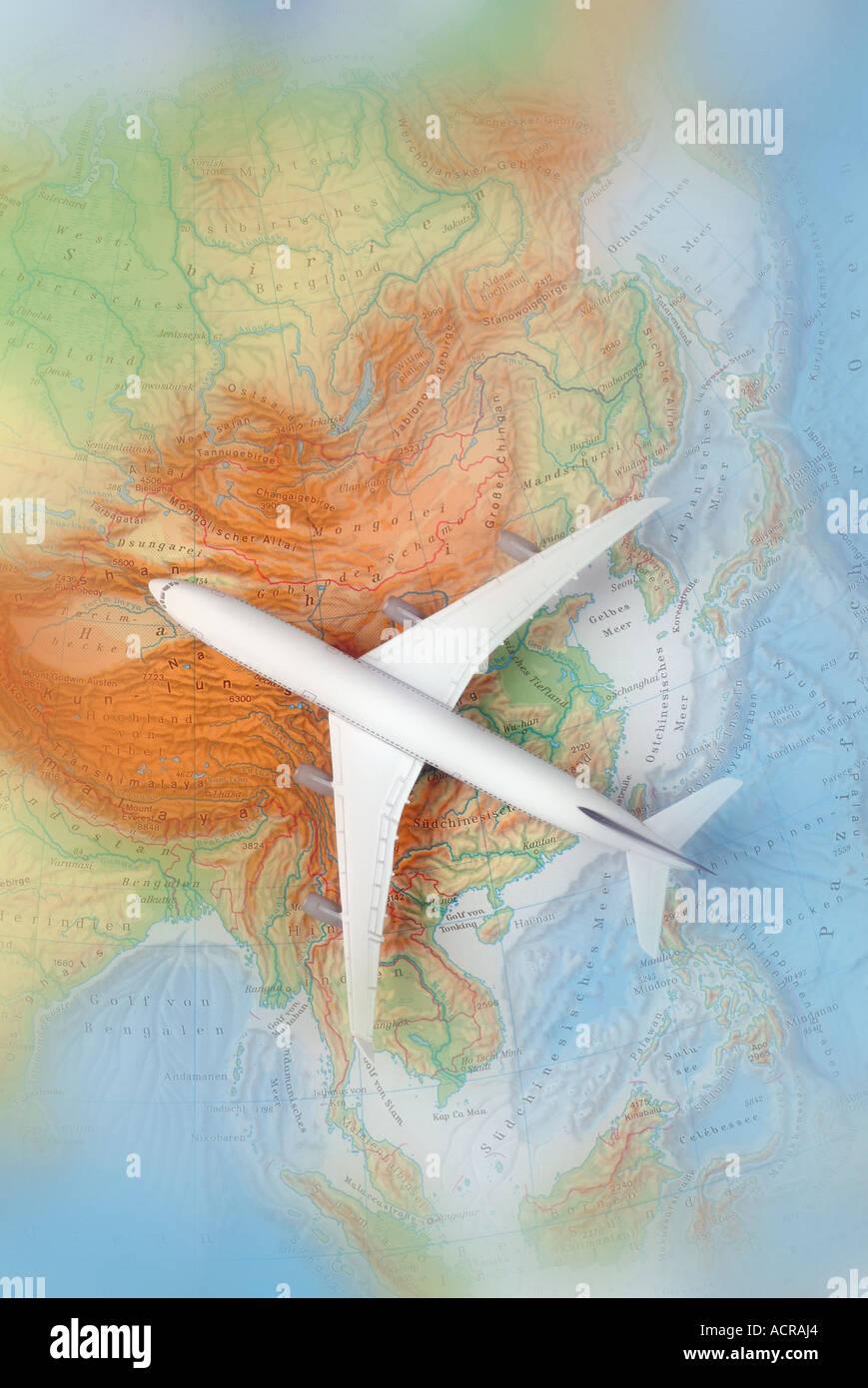 airplane on a map of asia Flugzeug auf einer Karte von Asien China Japan Korea - Stock Image