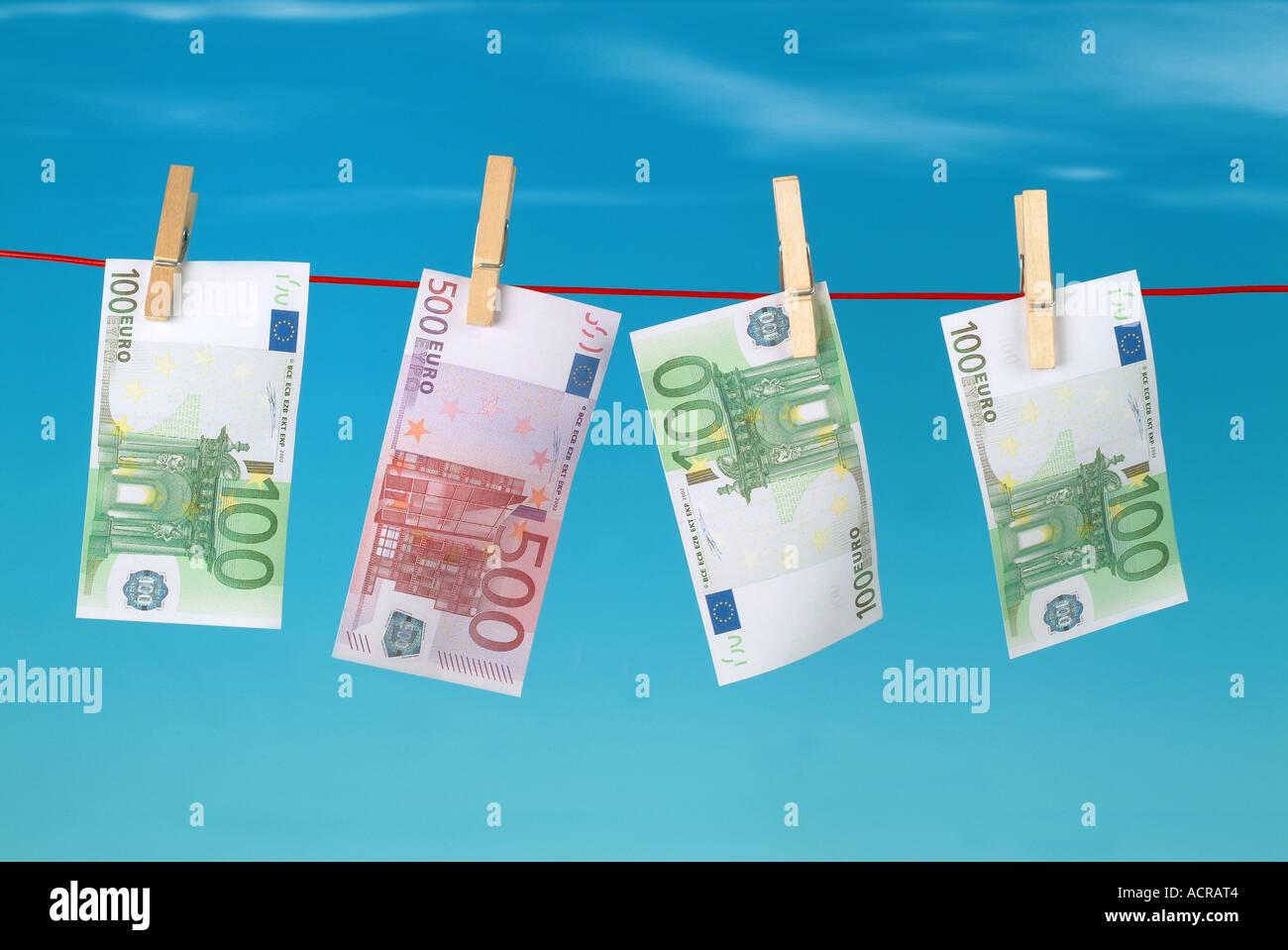 euros on a clothesline Euros auf Wäscheleine - Stock Image