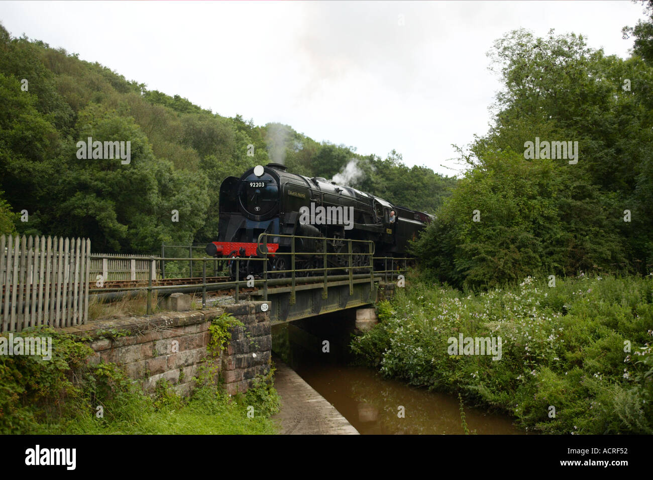 Churnet Valley Railway Steam train arriving at station - Stock Image