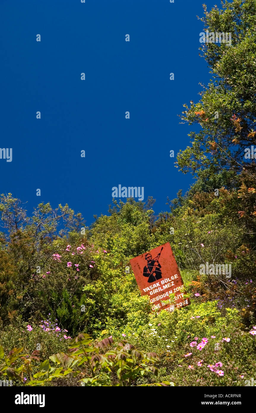 The Turkish Army's forbidden zone sign amongst wild Cistus, shrubs and trees at  Rumeli Kavagi, near Istanbul, - Stock Image