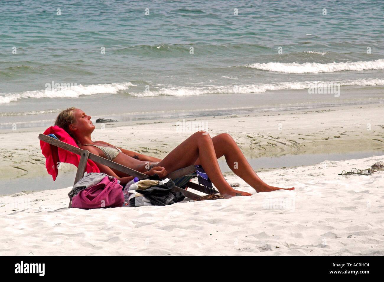 Young woman in bikini sunbathes in deckchair Ko Samet Thailand - Stock Image