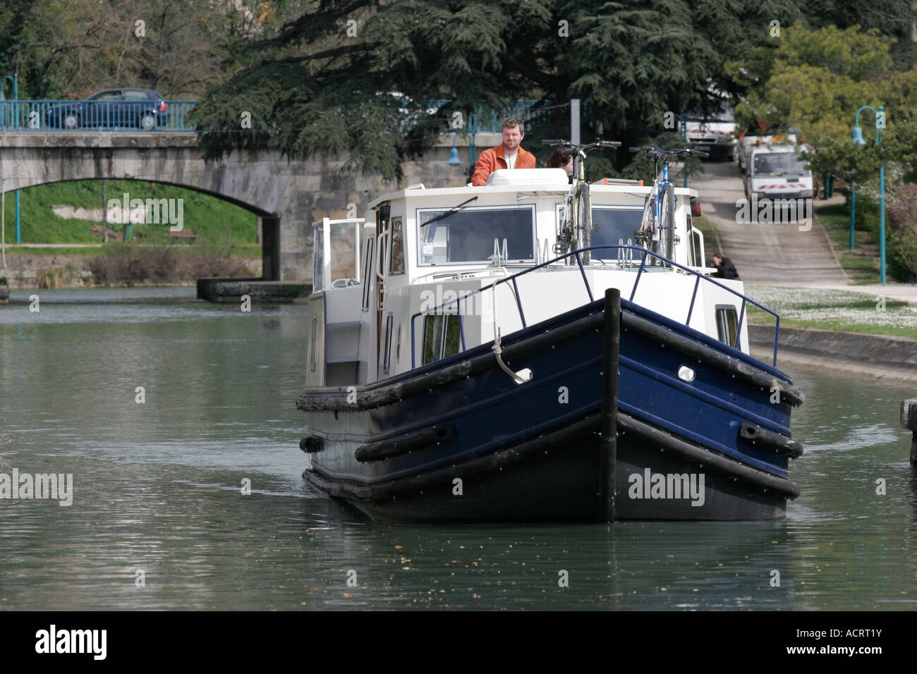 Holiday boat on the Lateral Canal Bridge at Agen, South West France - Stock Image