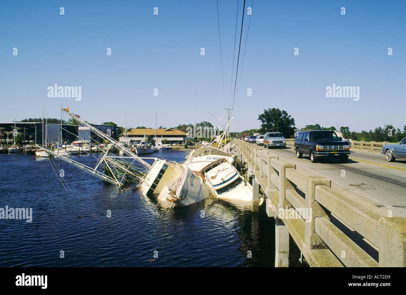 Gulf Coast storm tornado hurricane damaged shrimp fishing and pleasure boats at the Sponge Docks, Tarpon Springs, Florida, USA - Stock Image