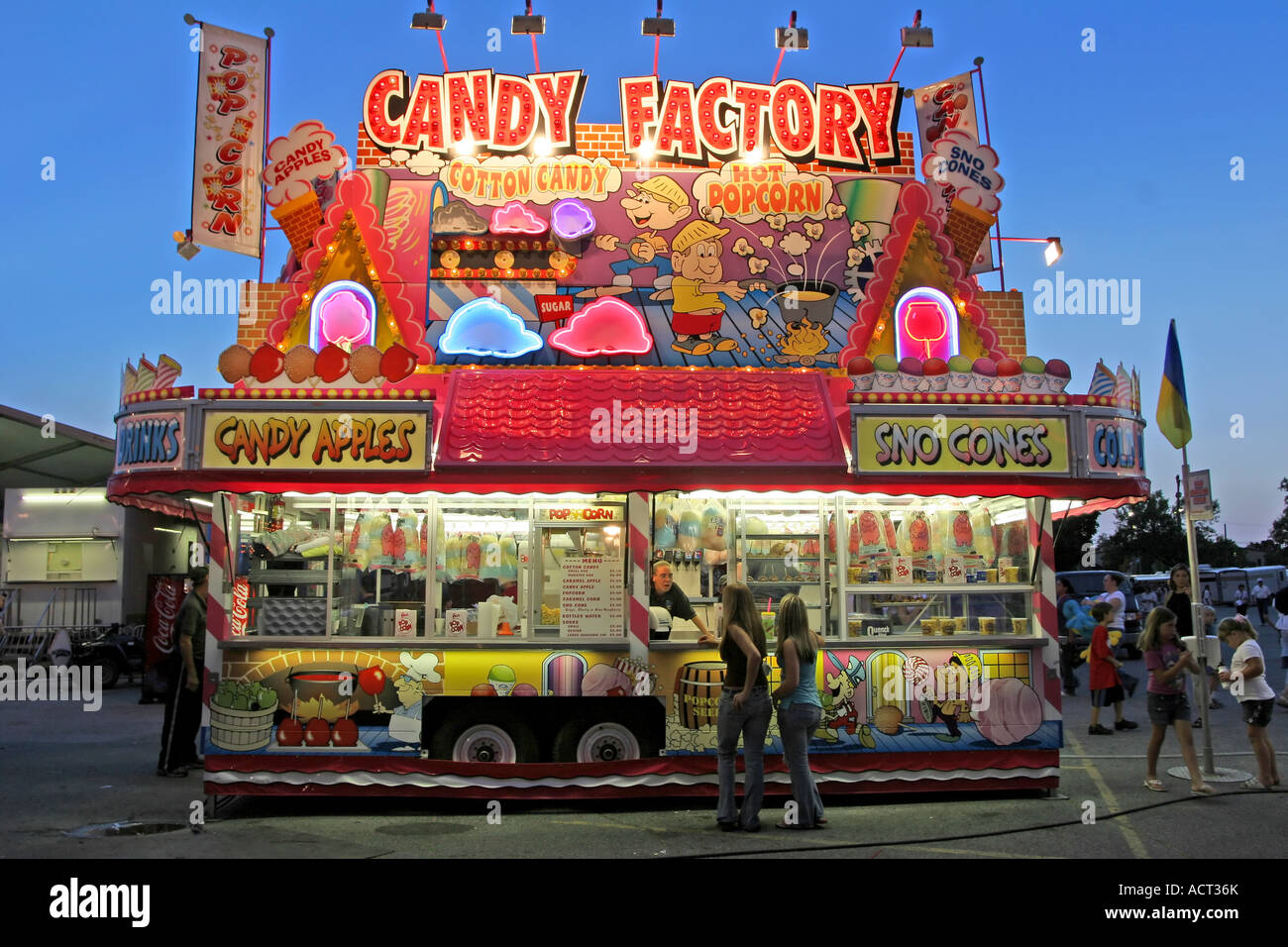 """Two women buy something at the """"Candy Factory"""", a food stand at the Stock Photo: 13222458 - Alamy"""