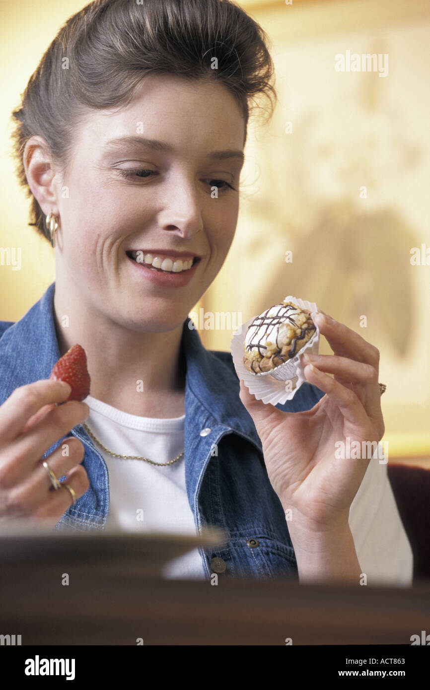 Caucasian woman with strawberry and cup cake Stock Photo