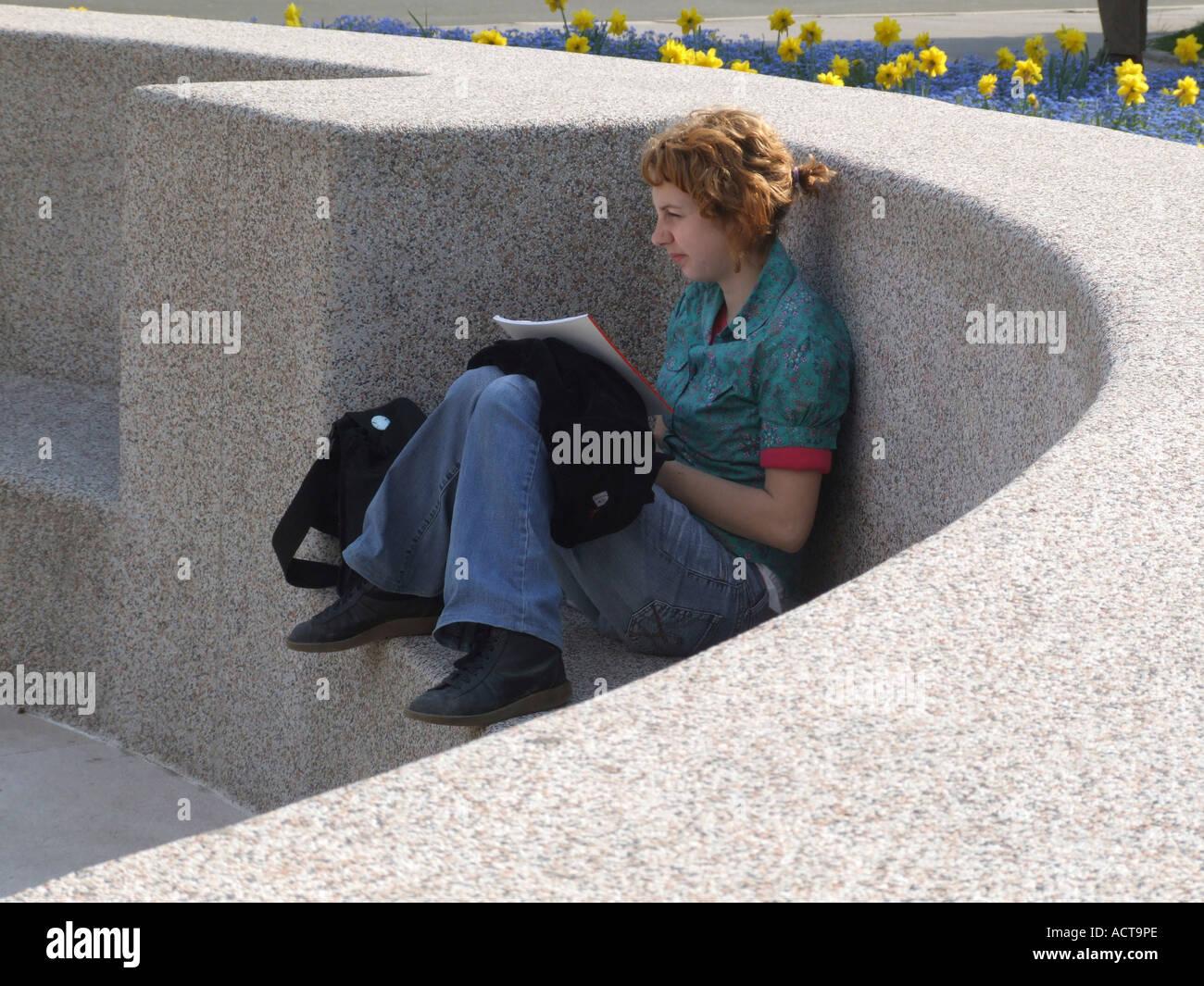 Student read book in park Zagreb Croatia - Stock Image