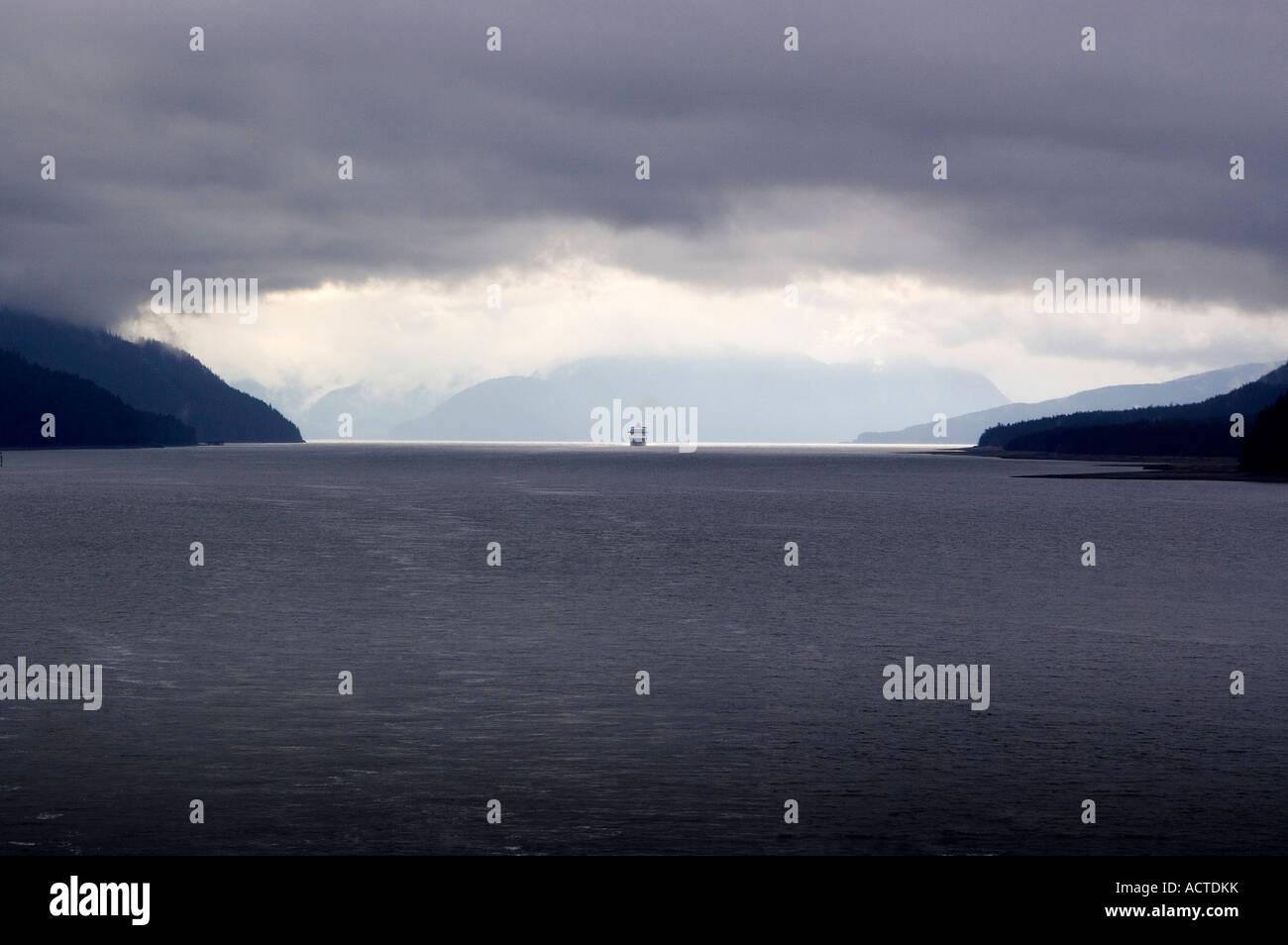 Cruise ship entering intercoastal passageway Alaska - Stock Image