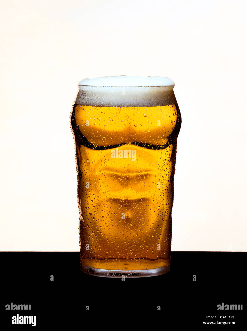 Strong Beer Strong Lager muscle man glass Strong Lager - Stock Image