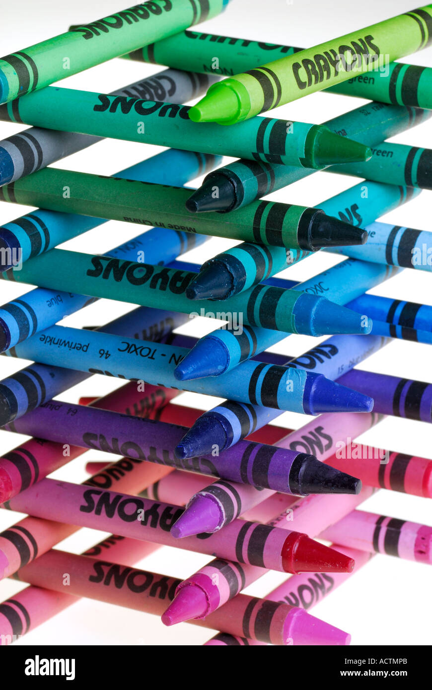 Multi colored crayons stacked up into a tower - Stock Image
