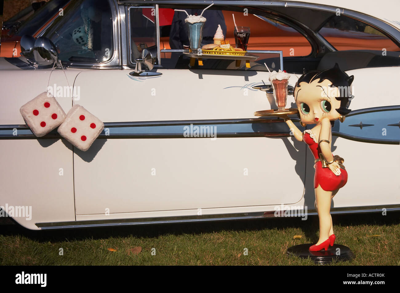 Betty Boop 1950s antique car and fluffy dice - Stock Image