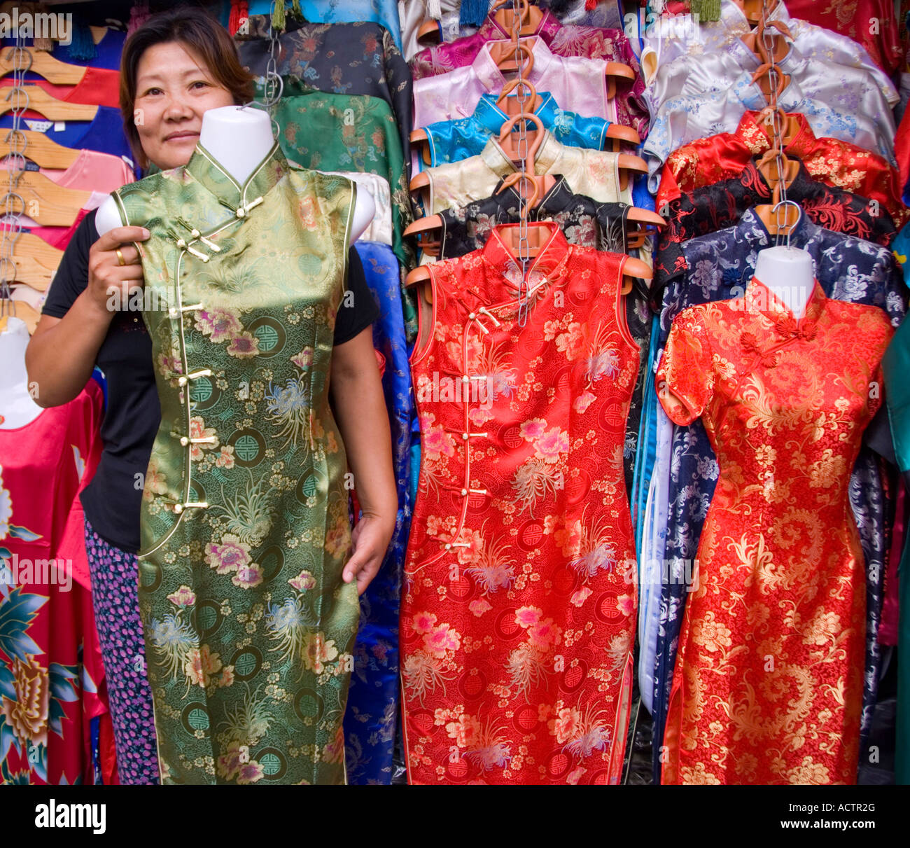 e9738861e Silk Chinese dresses on sale at market stall in Dashilan area of Beijing  2007
