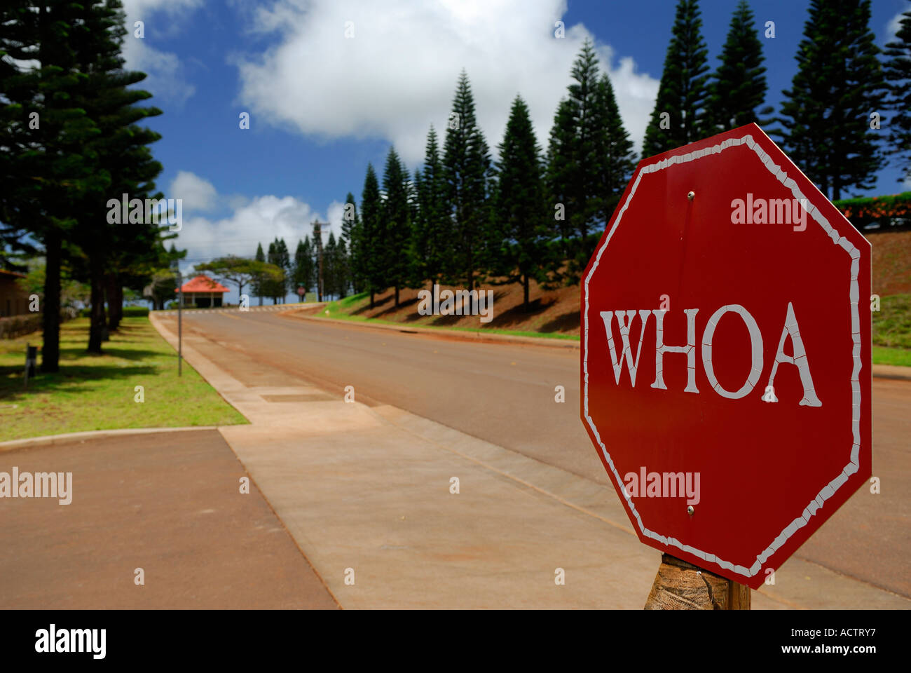 Red stop sign at Molokai Ranch that says WHOA Stock Photo
