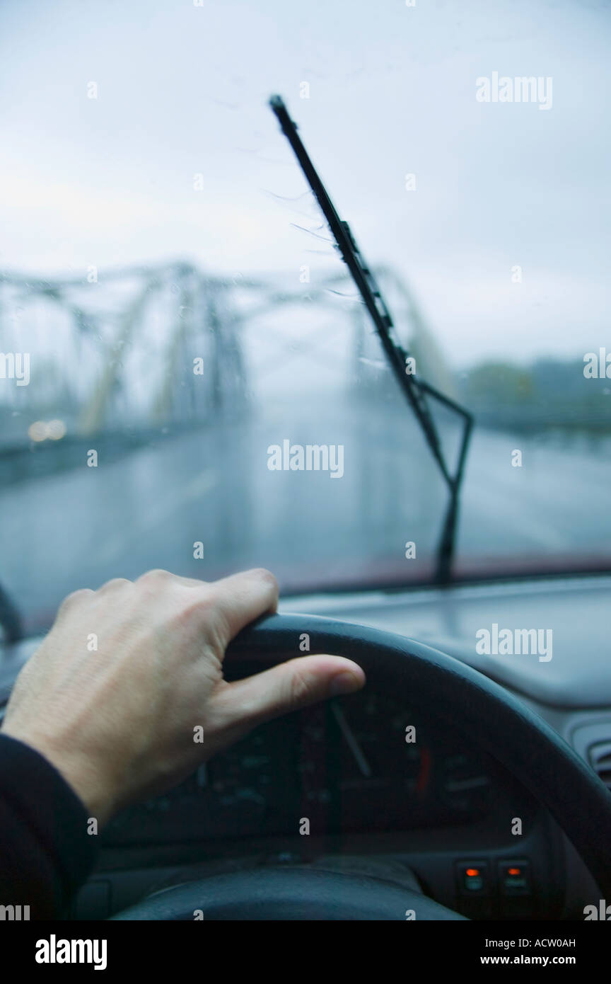 Drivers view through windshield on a highway in the rain - Stock Image