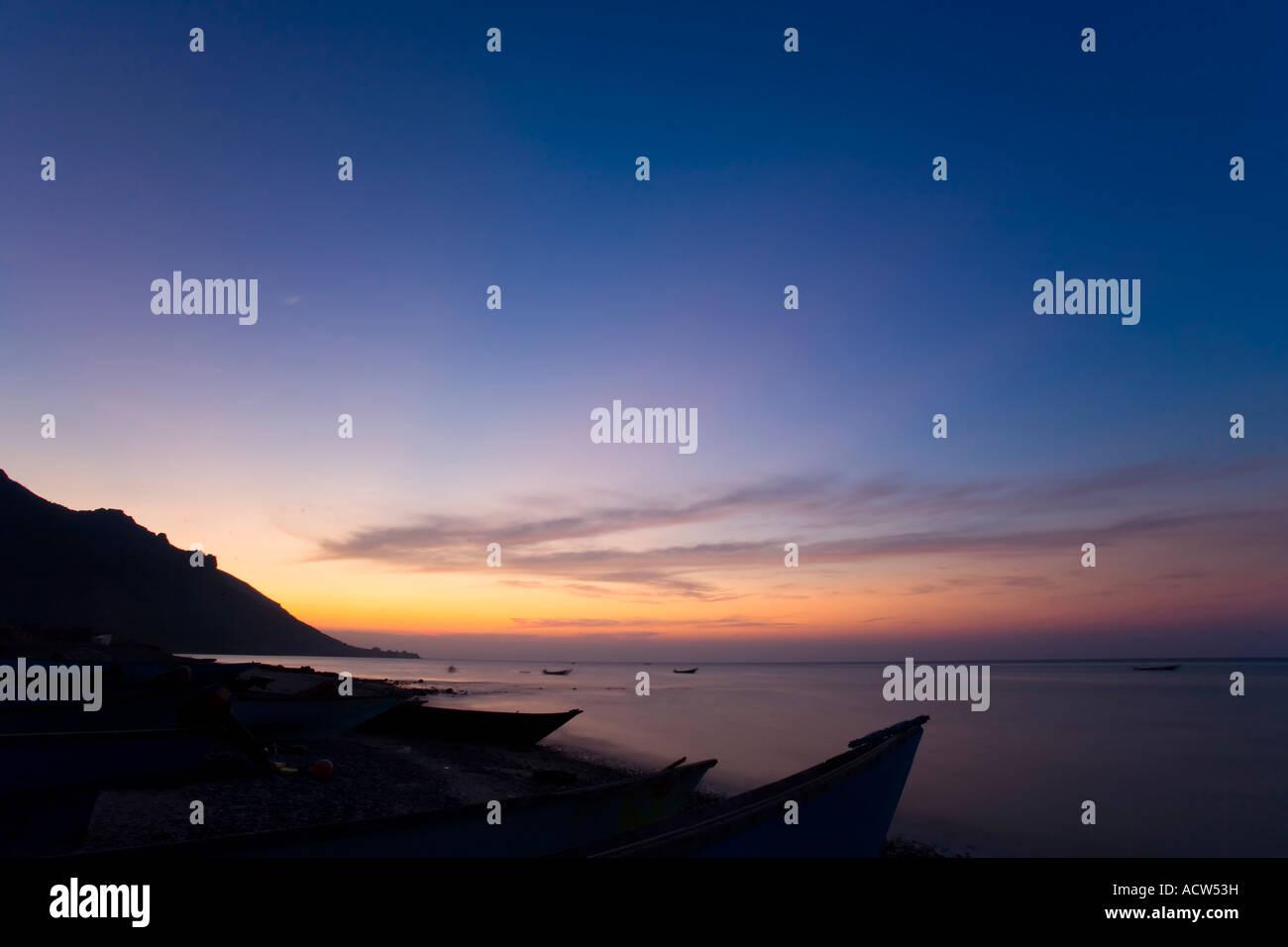 Sunset on the little harbour of Hadibu the biggest settlement of Socotra Island Yemen - Stock Image