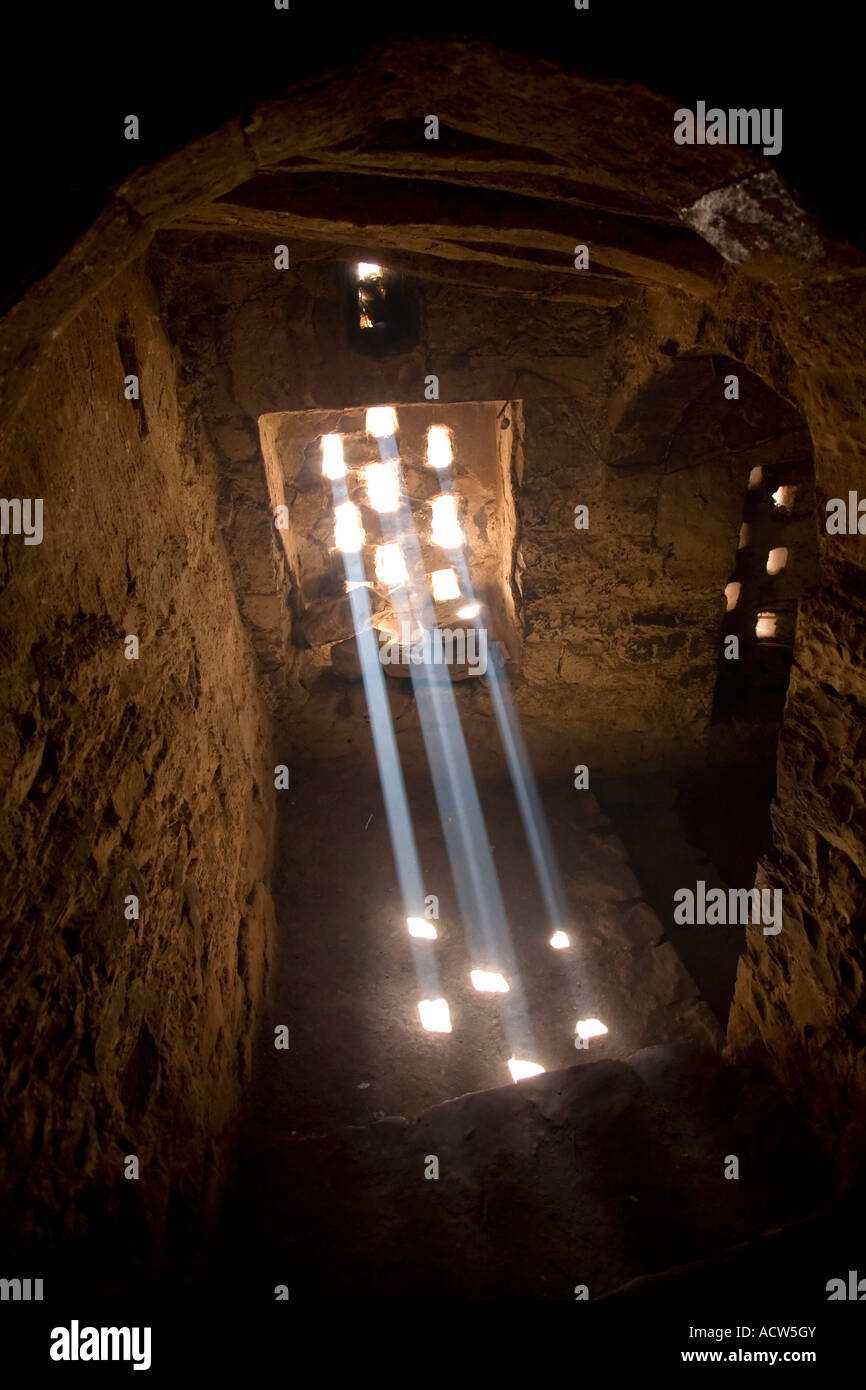 Beam of lights inside through the windond of a traditional house in the mountain village of Jibla near Taizz Yemen - Stock Image