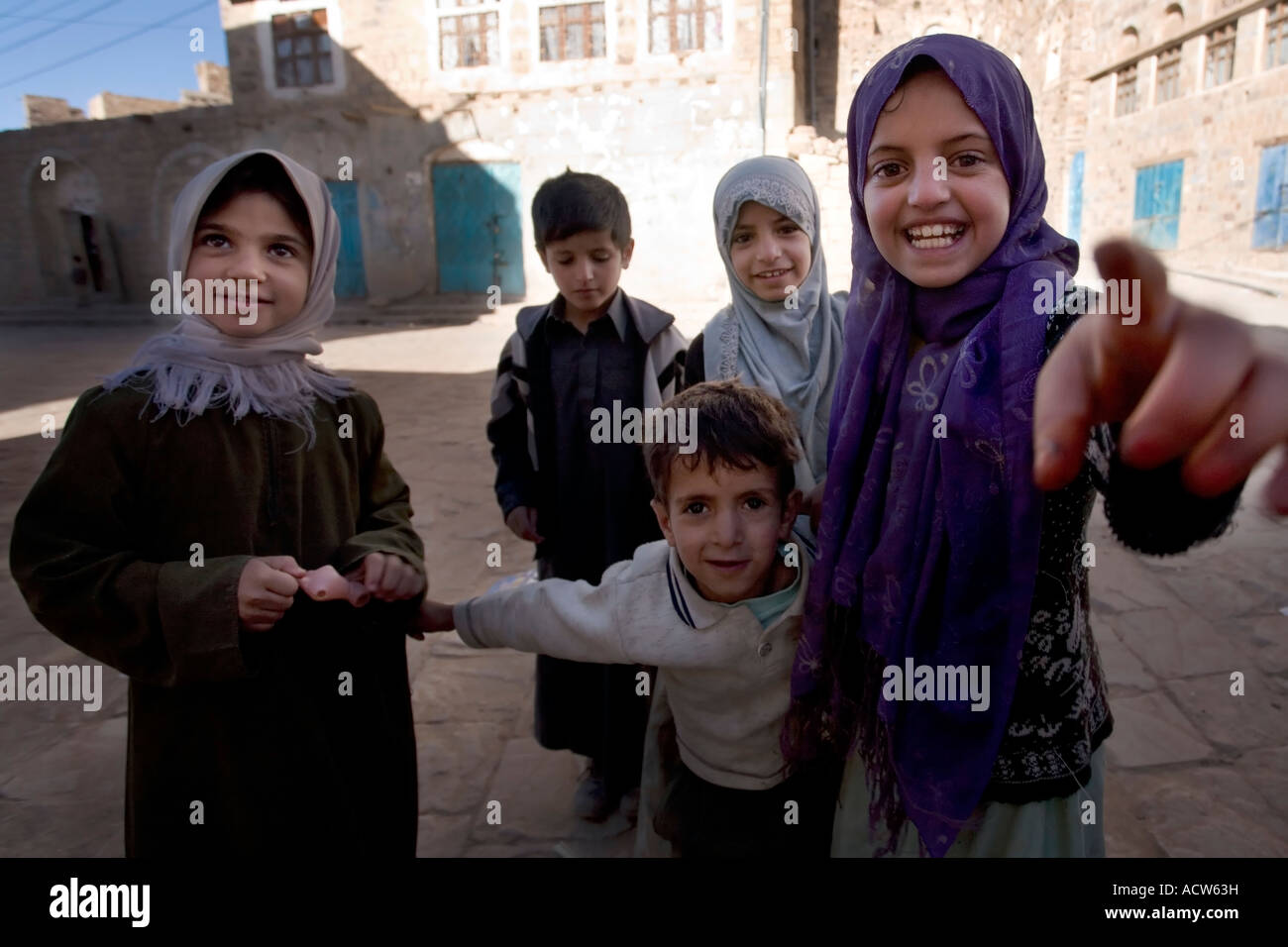 People along the streets of the old city of Thulla Yemen - Stock Image