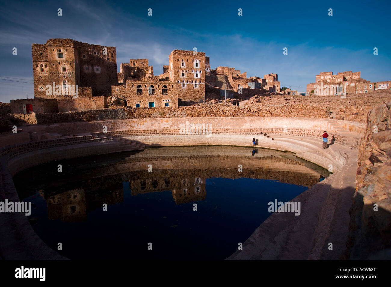 The cliffotop village of Shahara and its open air water cistern Haraz Mountains Yemen Stock Photo