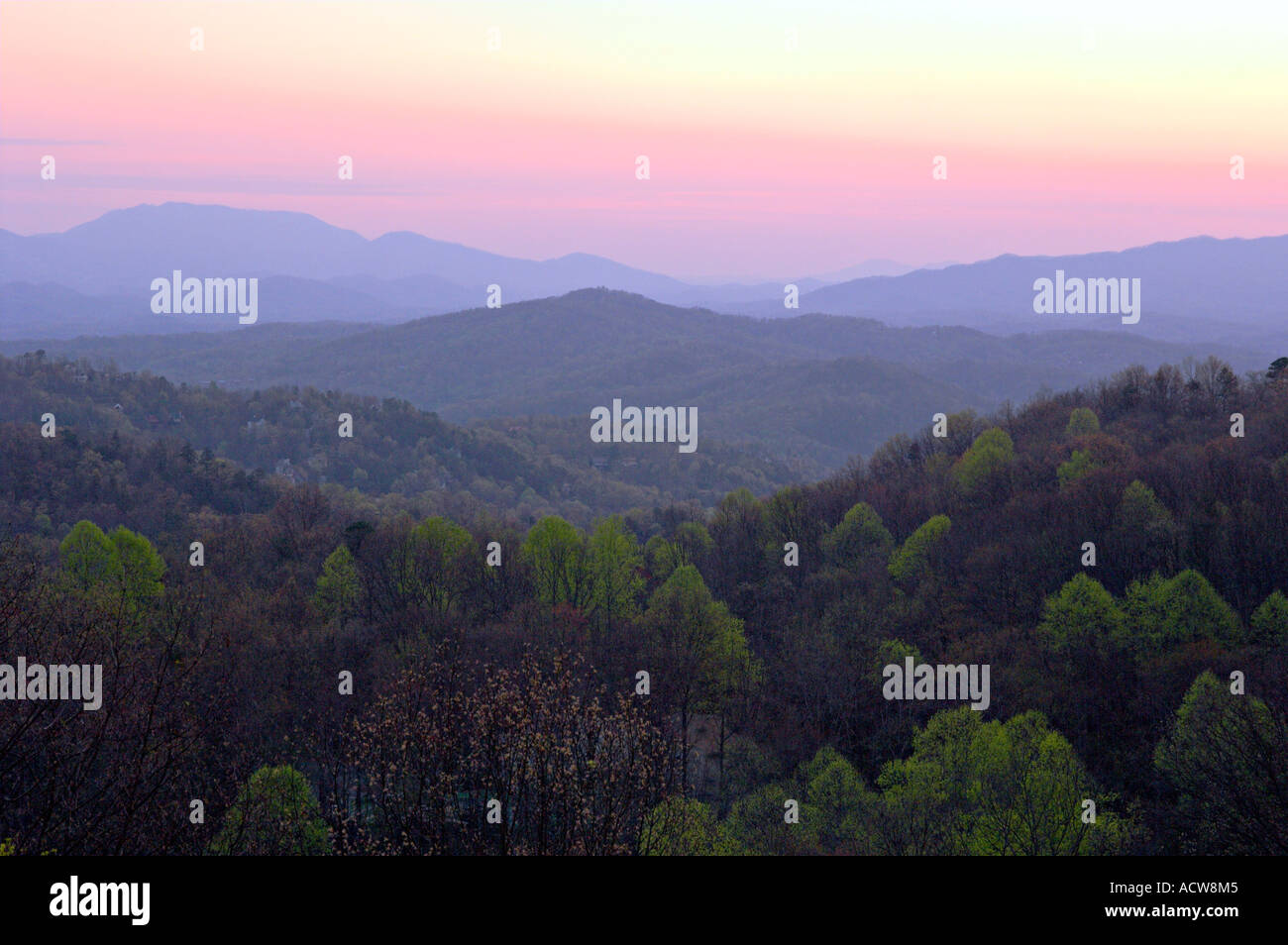 Layered mountains of the Smokies at sunrise from Ober Gatlinburg above the city of Gatlinburg Tennessee USA Stock Photo