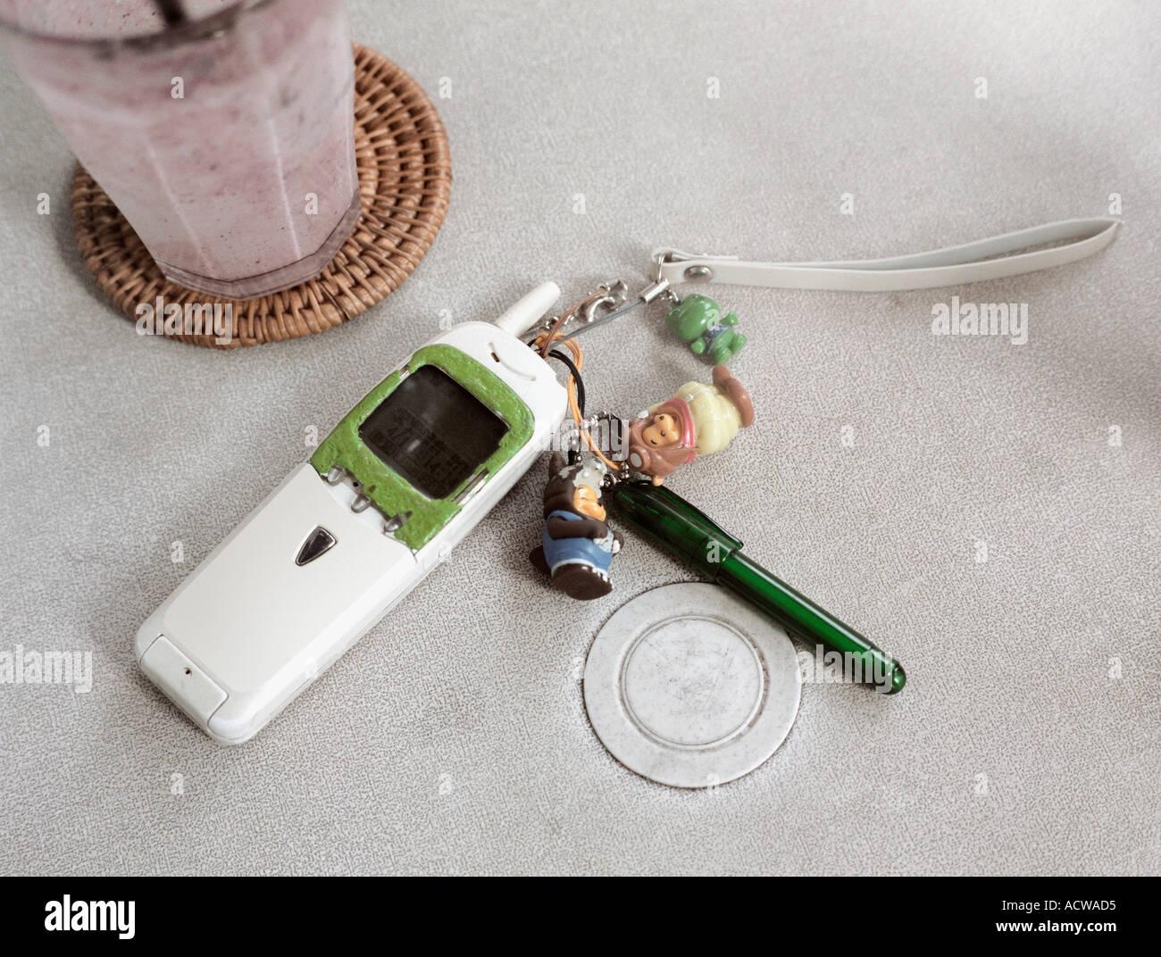 Cellular telephone and keyring - Stock Image