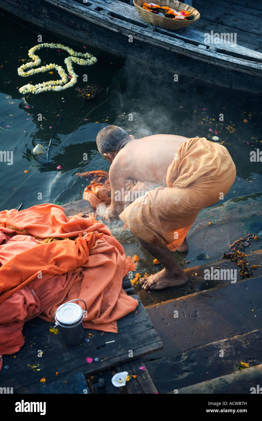A holy friar monk washes in the Ganges Varanasi Benares India - Stock Image