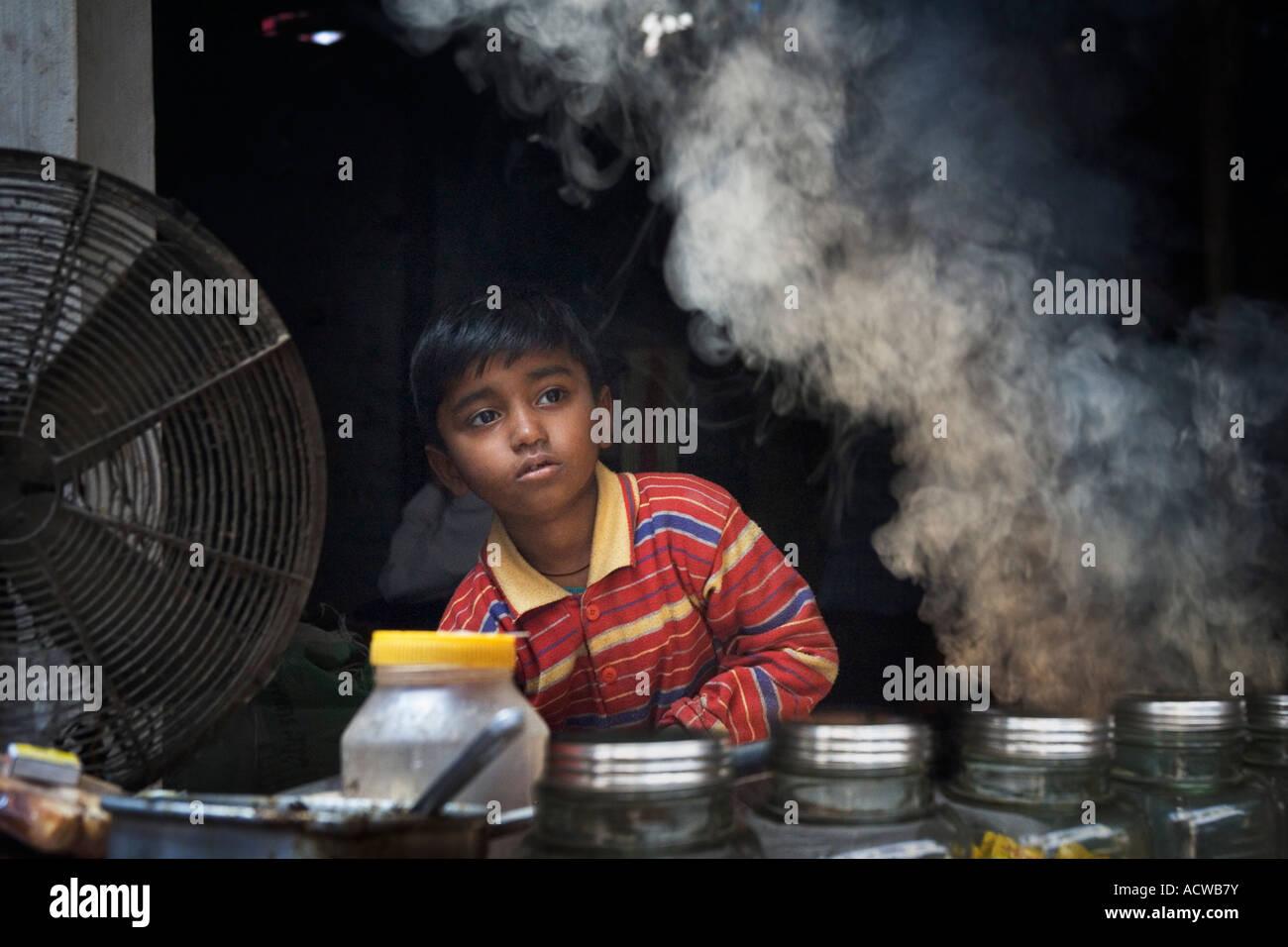 Young street vendor with smoke Varanasi Benares India - Stock Image