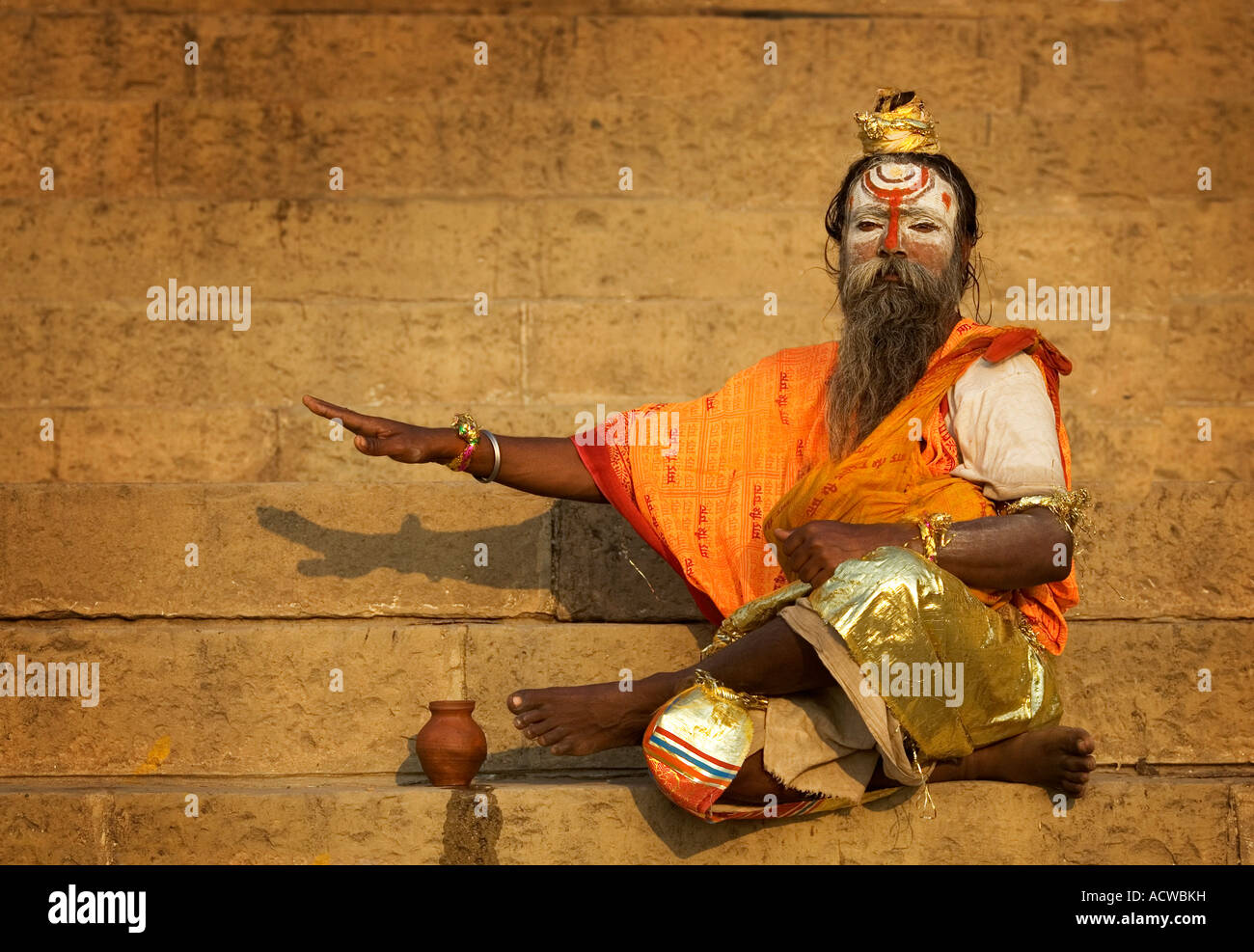 Priest at the stairs in the ghats Varanasi Benares India - Stock Image