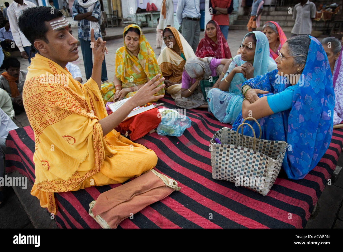 Priest in a class for women Varanasi Benares India Stock Photo