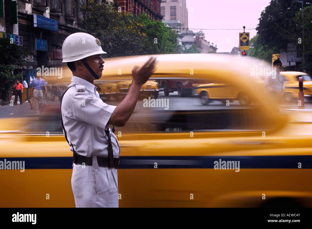 A constable traffic policeman directing taxis Calcutta Kolkata India - Stock Image