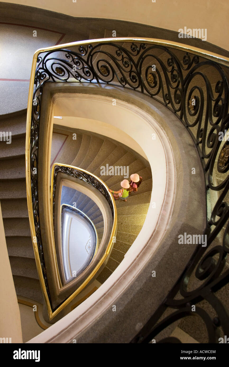 Spectacular staircase and two girls descending - Stock Image