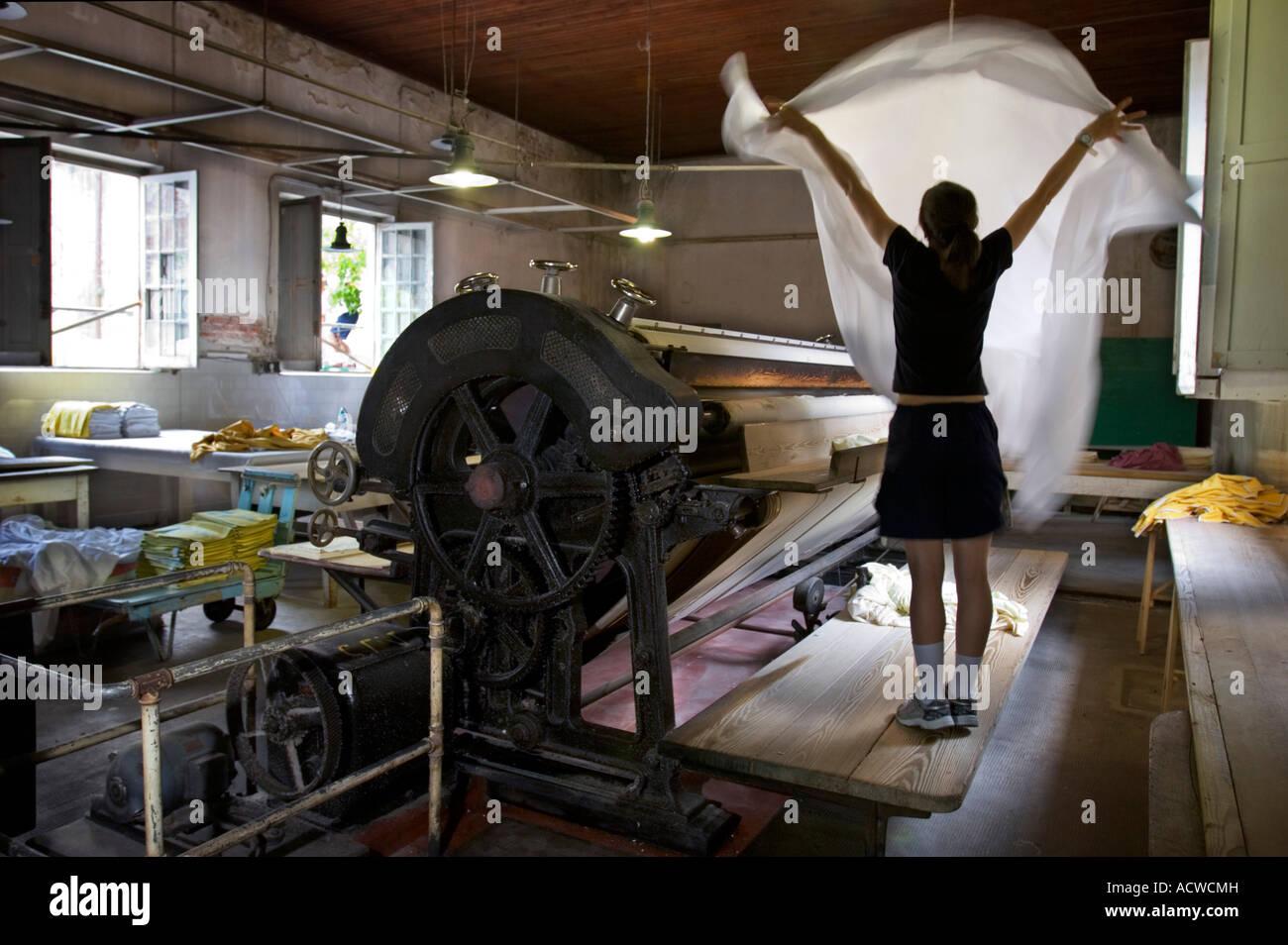 Antique Hotel Laundry Shop Sheet ironing machine - Stock Image