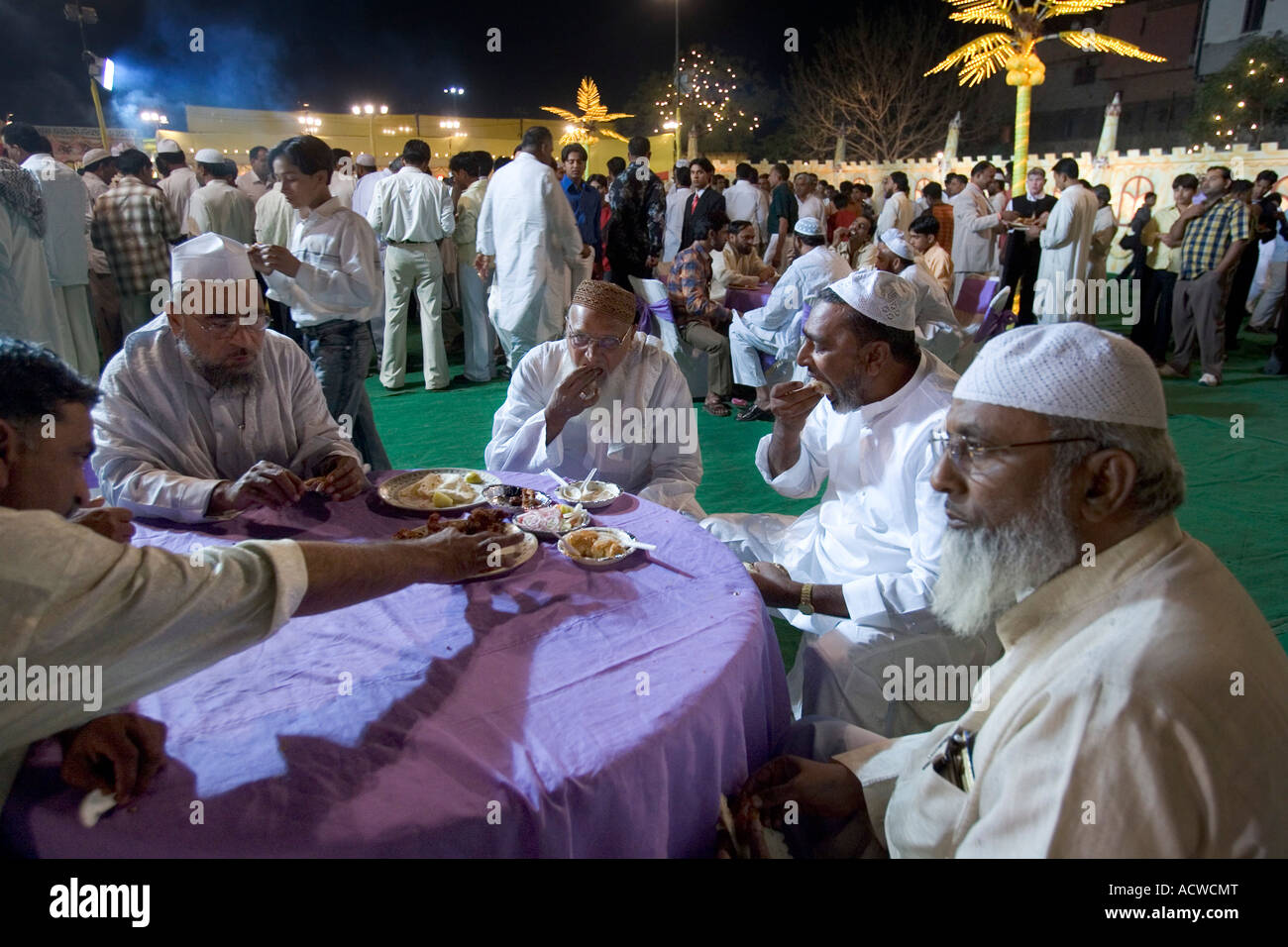 Men socializing at the Wedding of the son of the imam of Delhi India with soldiers and 2000 guests - Stock Image