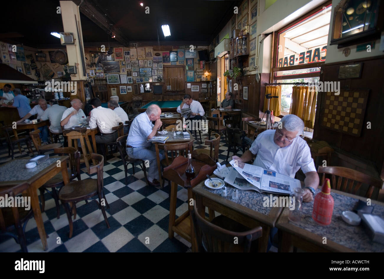An everyday scene in a classic bar in Buenos Aires Argentina with billiards chess - Stock Image