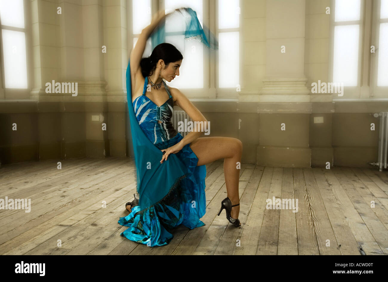 A woman dancer in a Blue dress in an old fashion dance hall Stock Photo