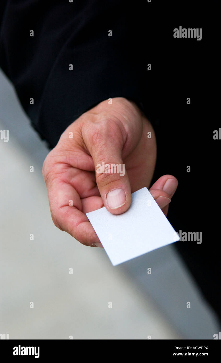Businessman handing out business card stock photos businessman businessman handing out business card stock image colourmoves