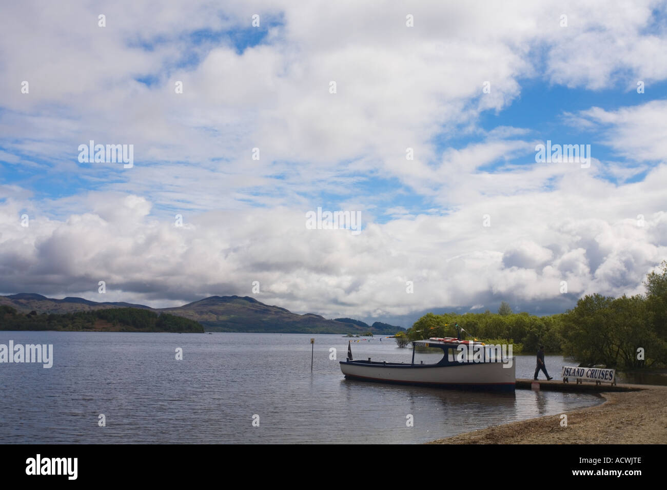 Luss Loch Lomond small boat trip in spring on sunny day Stirlingshire Highland Scotland UK GB British Isles - Stock Image