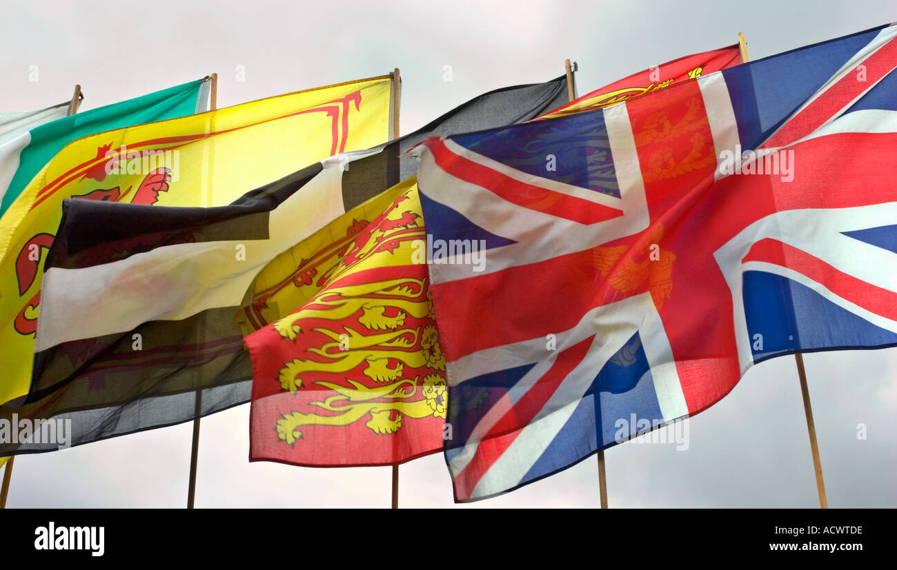Many flags flying in wind - Stock Image