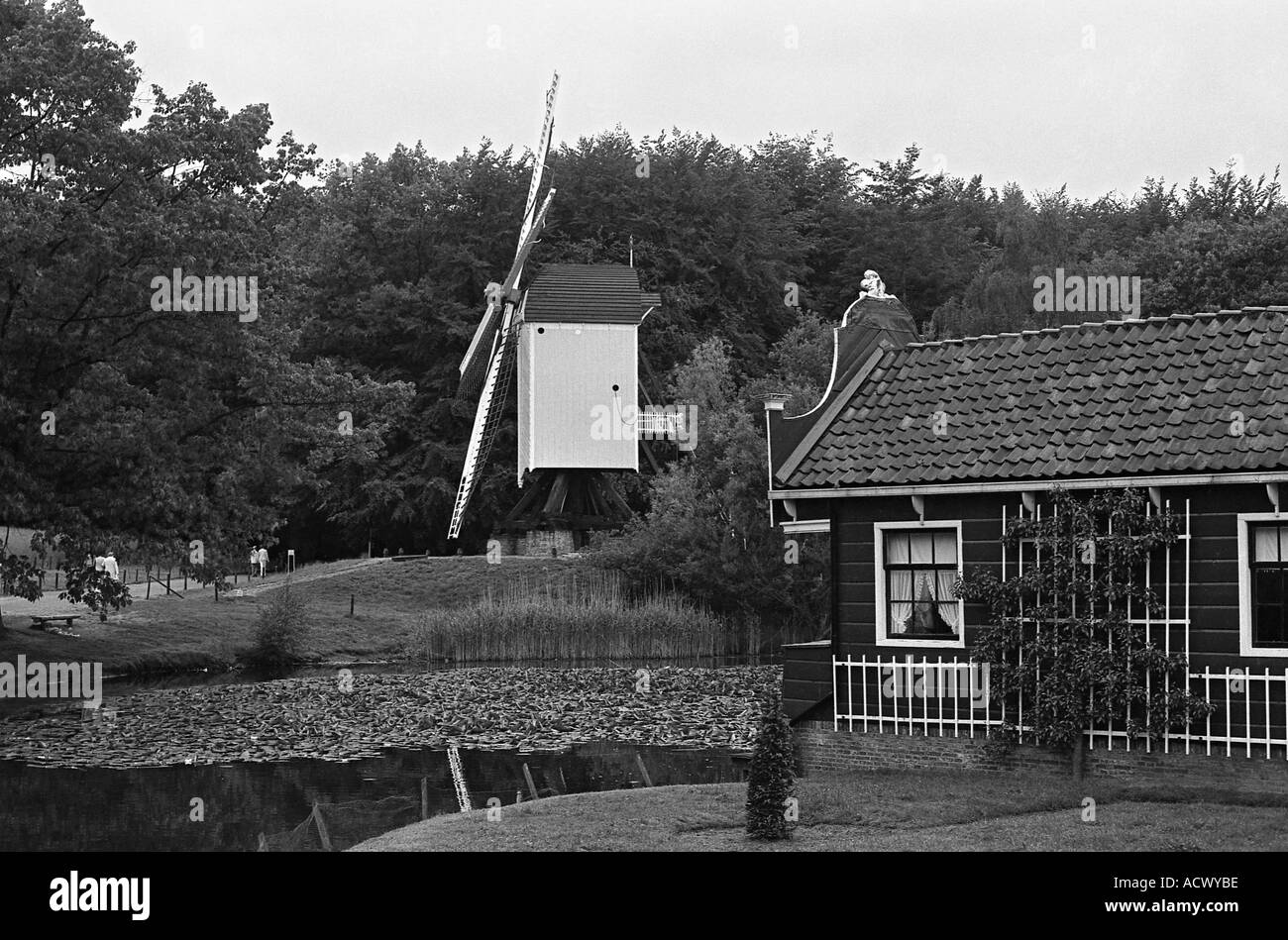 Post mill and farm house in open air folk museum in Holland - Stock Image