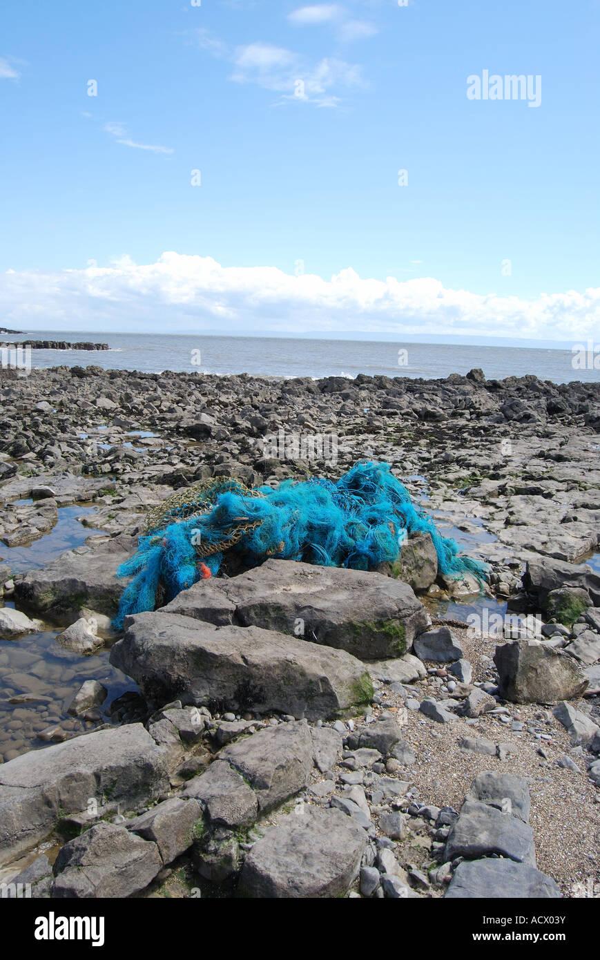 abandoned fishing net plastic waste no 2516 - Stock Image
