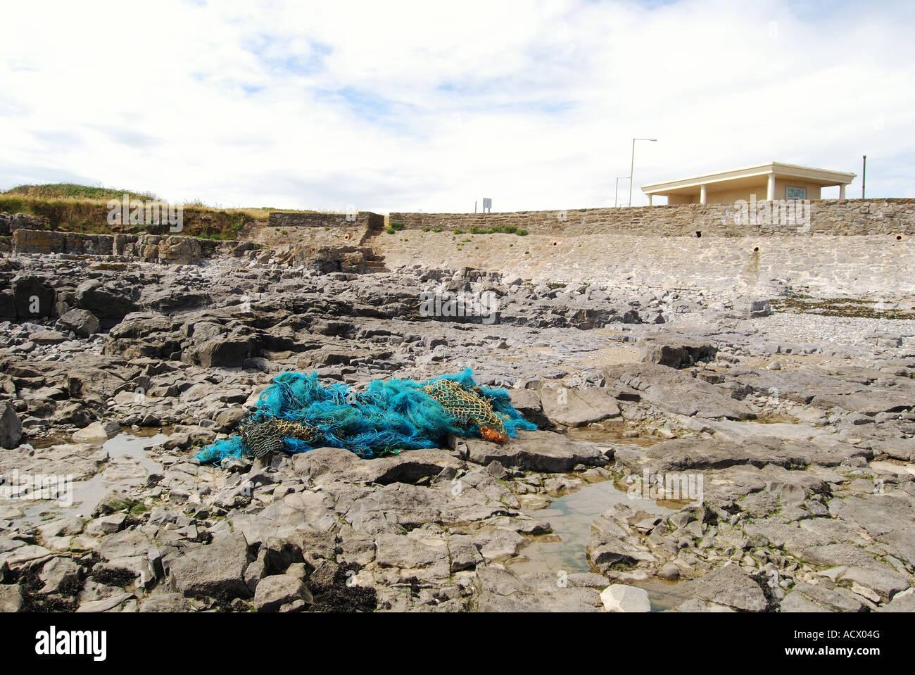 beached plastic fishing net no 2524 - Stock Image