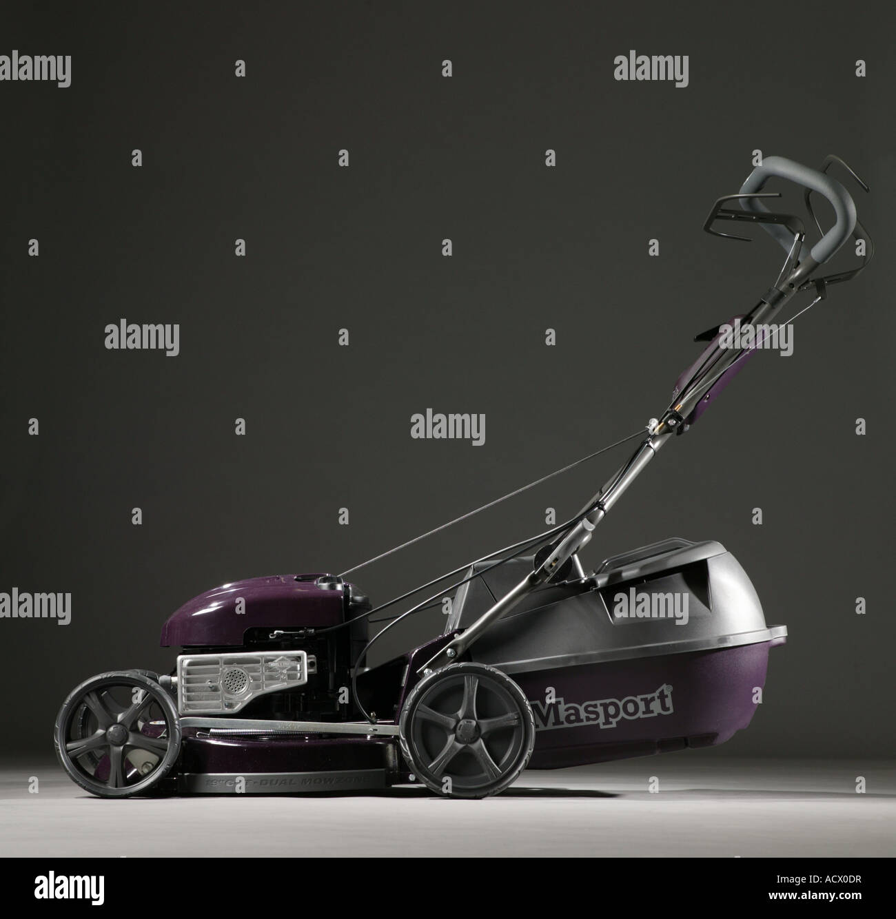 A Lawn mower against a dark background MASPORT MSV 550SP model pictured - Stock Image