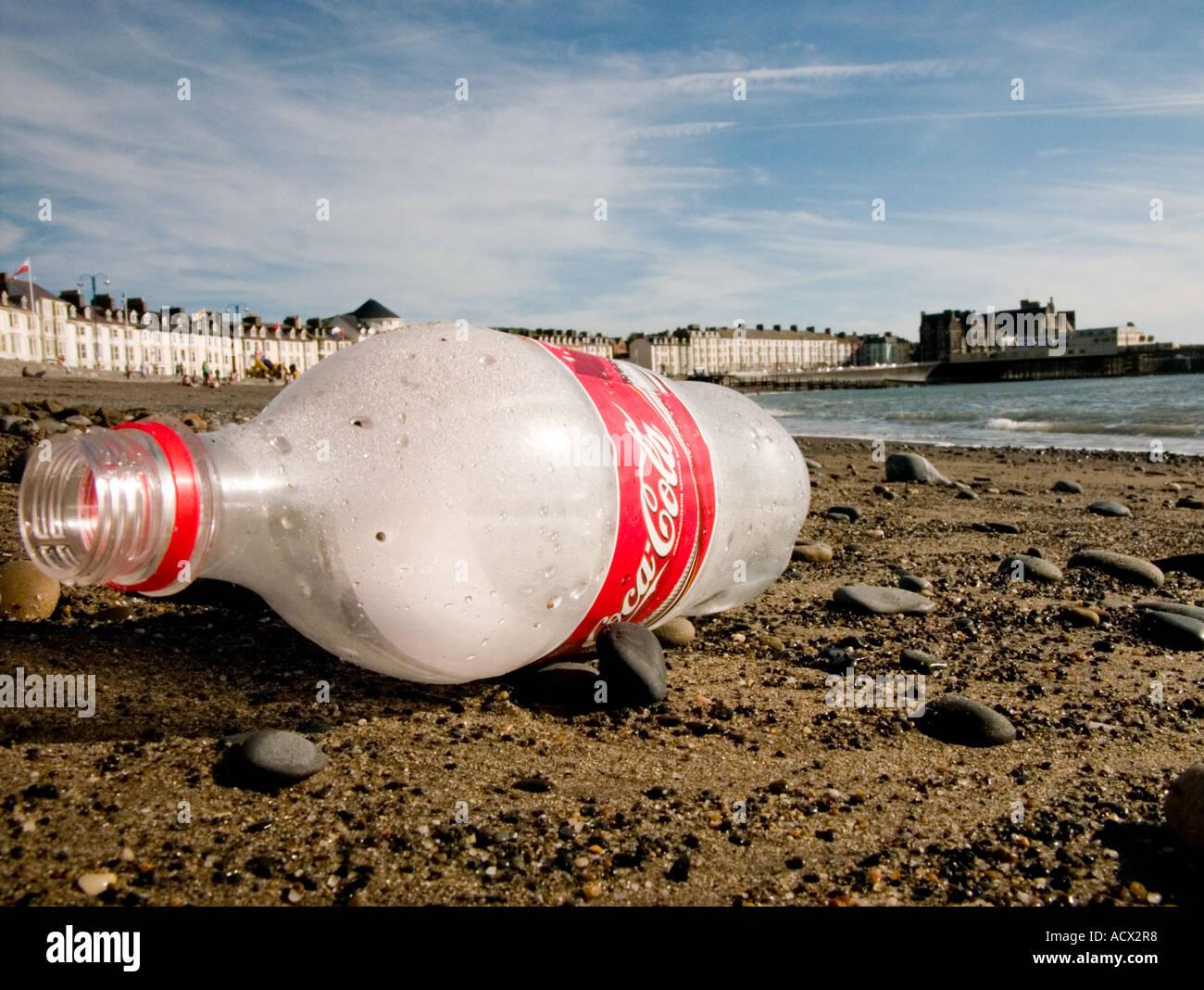 discarded coca-cola soft drink bottle on Aberystwyth beach summer UK Stock Photo
